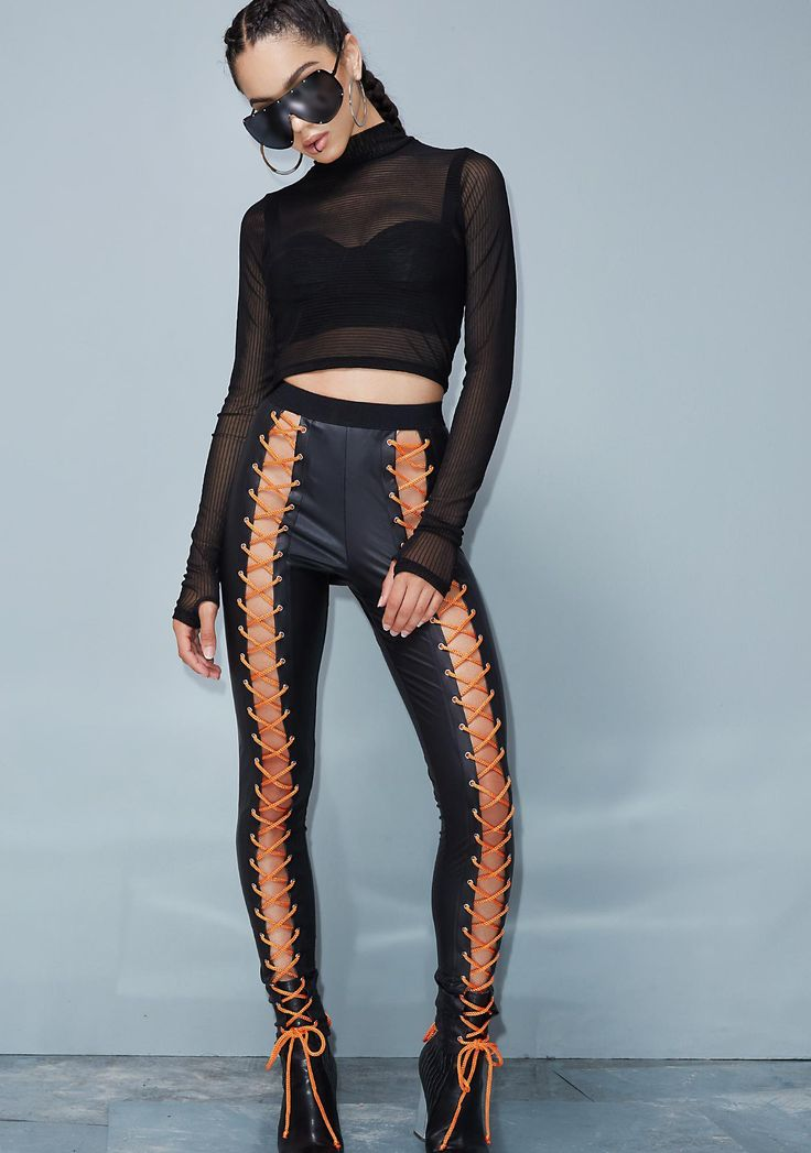 Poster Grl Backseat Nancy Corset Leggings party in the front, party in the back...these sikk af leggings have a stretchy fit, elastic waistband and sexxy adjustable orange laces up the front and back!