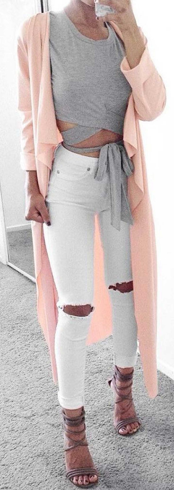 gray wrap around top, peach duster, white ripped jeans, strappy heels. #outfit #lotd #trendy