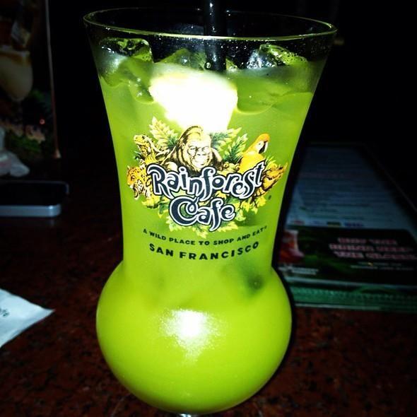 Green Python Recipe served at Rainforest Cafe in Downtown Disney at Disney World 1 part Skyy Citrus vodka 1 part Midori Melon liqueur 1 part Malibu Coconut rum 1 part 99 Bananas liqueur 4 parts sweet & sour 4 parts pineapple juice.