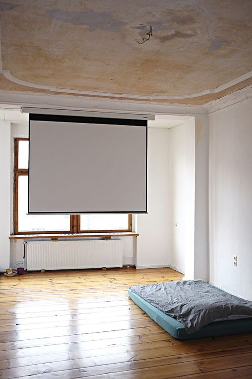 i really like the idea of having a projector screen installed in our bedroom / living room together with a projector instead of a tv screen