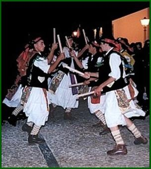 "The other costume is what we call ""Pauliteiros of Miranda do Douro"" and are typical in Northeastern Portugal. They basically are men in skirts who dance at the sound of bagpipes (traditional Portuguese music) with sticks."