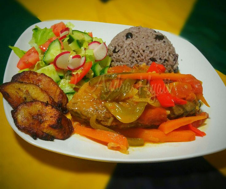 Rice and bean with stewed king fish a vegetable salad and fried plantains  #riceandbean #kingfish #jamaica