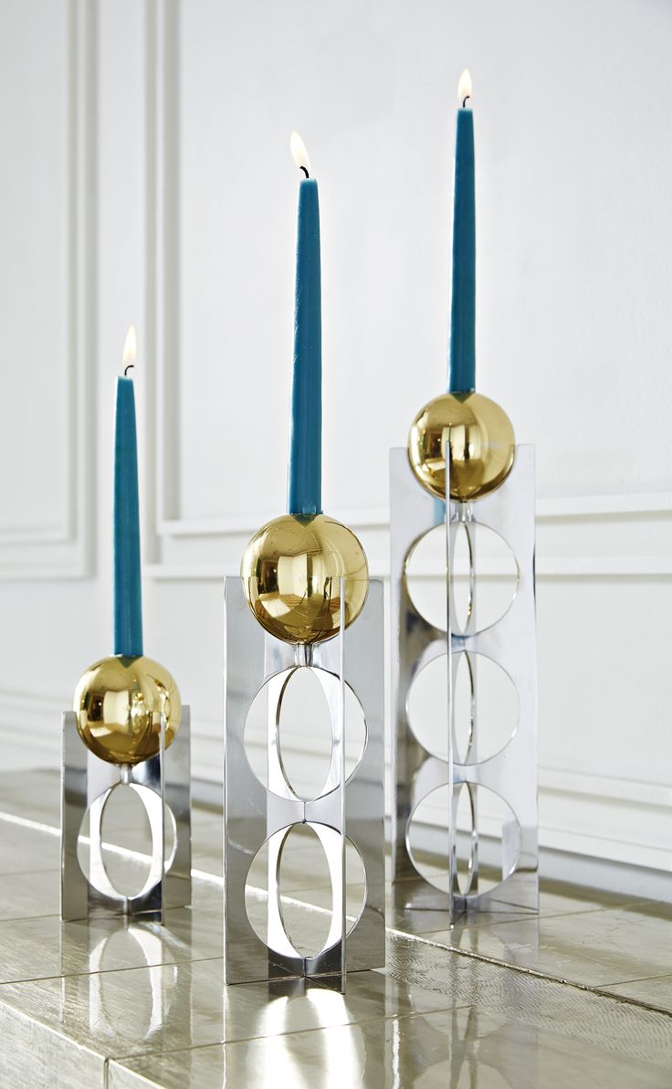 Jonathan Adler Berlin Candle Holders come in three different sizes. Mix and match heights to create an architectural skyline on your mantle or dining room table.  An elemental exploration of mixed metals, Wiener Werkstätte austerity, and futuristic glamour.  A steel x-base with mod circle cutouts supports a brass sphere candle holder.