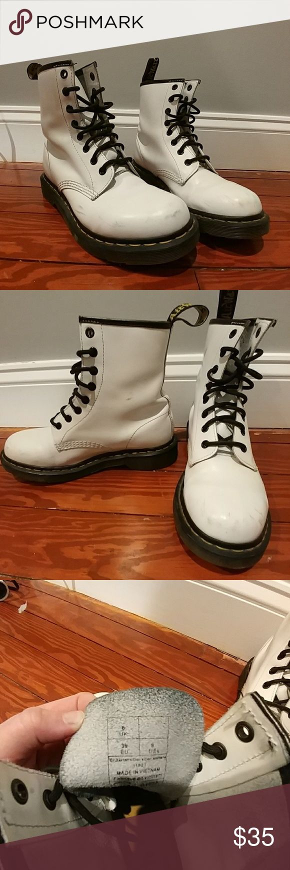 White Dr. Martens Size US 8 White Dr. Marten boots. US 8 UK 6. Some scuffs on toe and indents on back of ankle from wearing. Worn a few times in winter conditions. Great snow boots that are stylish and warm. Inside of boot is like brand new. Dr. Martens Shoes Winter & Rain Boots