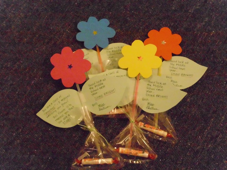 """I made these flowers as a goodbye gift for the 5th graders I was student teaching! I got all these materials at the dollar store: foam for the petals, star stickers for the stigma, glow sticks for the stem, tagboard for the leaves, and plastic goody bags to hold the smarties. (The petals read: """"You are a class of Smarties - I enjoyed watching you grow! This flower is to remind you that you are a star! Good luck at the Middle School next year... SHINE BRIGHT!"""" The students loved them <3"""