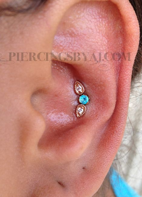 Tumblr Fresh triple conch with 14K rose gold Pear Harlequin with white CZ gems from BVLA and a 3mm genuine paraiba topaz center piece from Anatometal.