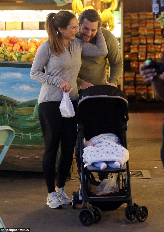Plenty to smile about: Sam Faiers settled into LA life with a trip to a farmers' market with her partner, Paul Knightley, 27, and their cherubic tot, baby Paul, 14 months, on Tuesday afternoon