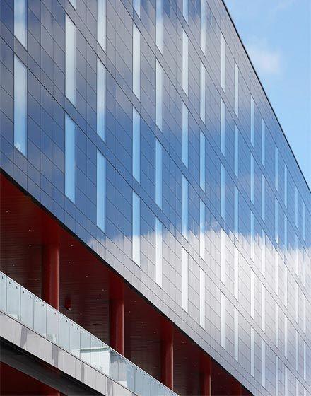 Wembley Hilton, The Manser Practice #cladding #ceramic #granite #stone #panels #modern #clean #simple #minimal #minimalist #modern #modernist #clean #flush #reflective #black
