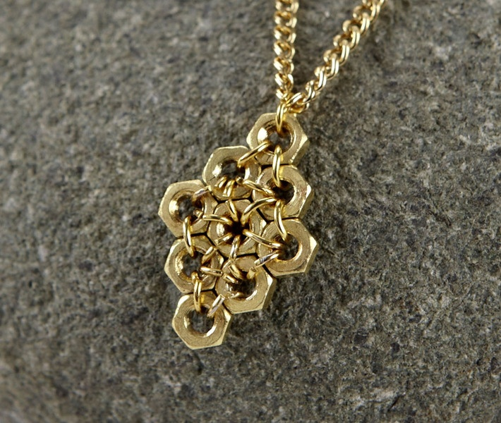 hex nuts and jump rings pendant. Pretty idea although I would carry it out differently.