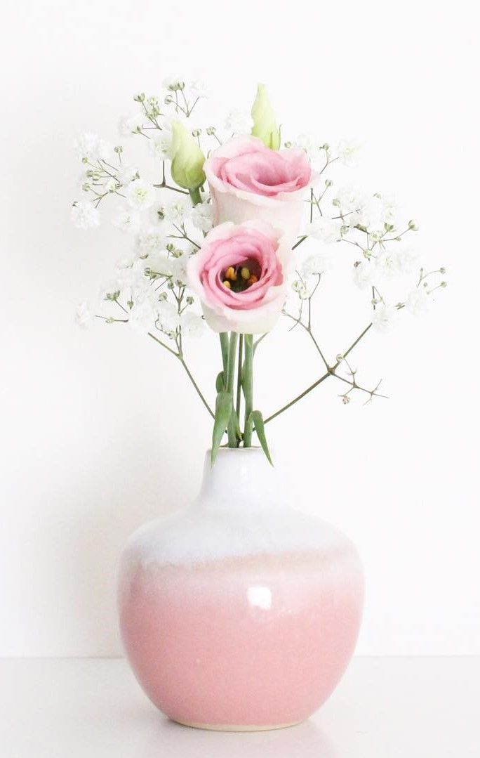 Sass & Belle Dip Glazed Ombre Round Vase Pink £4.50 - Our Dip Glazed Ombre Round Vase is a delightful addition to any home requiring a little touch of rustic charm. The subtle shade of pink against the natural tan and white brings an element of soft colour to a room. Paired with your favourite leaves or flowers, this vase is a home accessory must-have. Dishwasher and microwave safe.