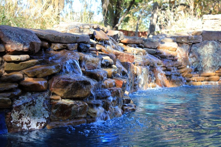 Beautiful rock swimming pools home design and interior for Natural rock swimming pools