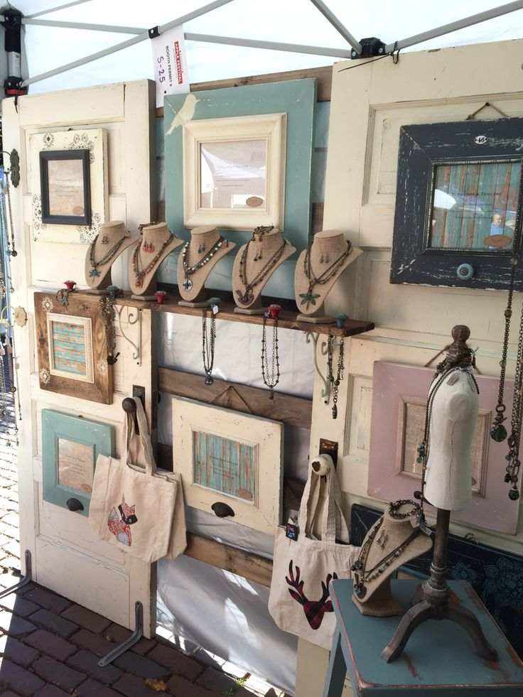 Side wall of my display at Bayfield Applefest. Craft fair jewelry display necklace rack art fair tent walls old doors vintage shelf knobs iron brackets rustic booth setup mannequins burlap busts dress forms