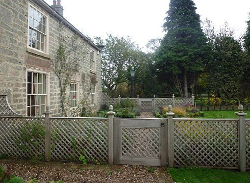 diamond trellis fence panels painted a heritage shade of grey