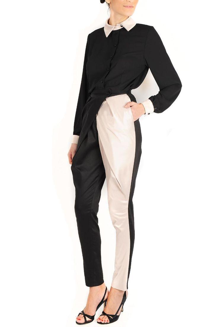 Pantaloni conici din bumbac satinat. Recomandari de stil: adauga acestui pantalon fantezie bicolor o camasa si un sacou cambrat sau un tricou si incaltaminte cu toc