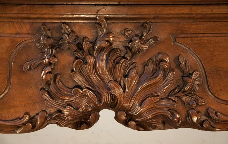 Large antique Louis XV period fireplace made out of carved walnut