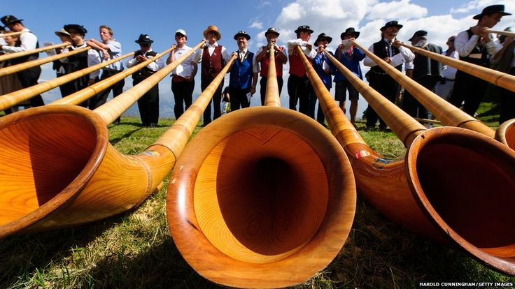 Blowers perform on the last day of the international Alphorn Festival of Nendaz, Switzerland.