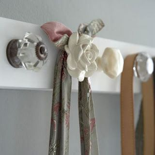 Decorative Hook Rack made from drawer/cabinet knobs and a piece of wood. So simple yet so useful.