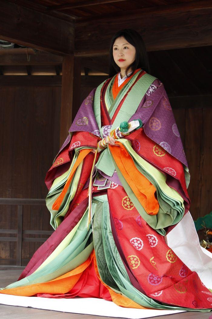 Wearing Heian-period-style court multi-layered kimono.Japan
