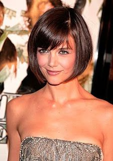 a-line bob hairstyle with bangs | Attractive brunette with a classic bob haircut with slanted bangs