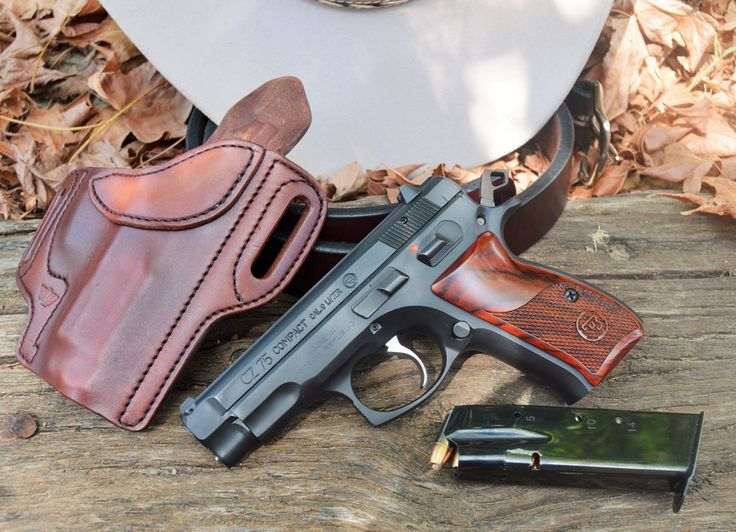 """Andy writes … This is my """"BBQ"""" gun setup; a CZ 75 Compact, a Wright leather works holster and belt and a felt Justin Hat (hello from Texas!). The CZ 75 has hardwood CZ grips and has had every spring replaced by me with Cajun Gun works springs, I highly recommend them! It's not only …   Read More …"""