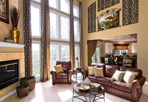 High ceiling big windows great room wall art for that Two story living room decorating ideas