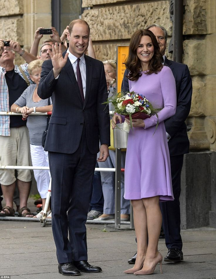 Lucky Kate! The Duchess was presented with a beautiful bouquet of flowers after touching d...