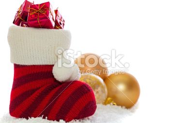 Christmas stocking with decorations isolated over white Royalty Free Stock Photo