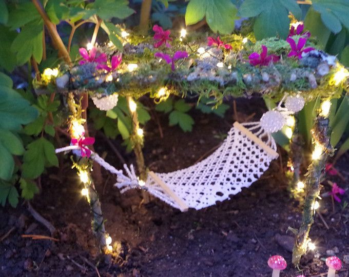Oh my gosh! Those teeny tiny fairy lights are perfect with this crochet hammock! Our Fairy Garden needs this pronto.  I found so many cute Fairy Garden ideas on this site. (Affiliate)