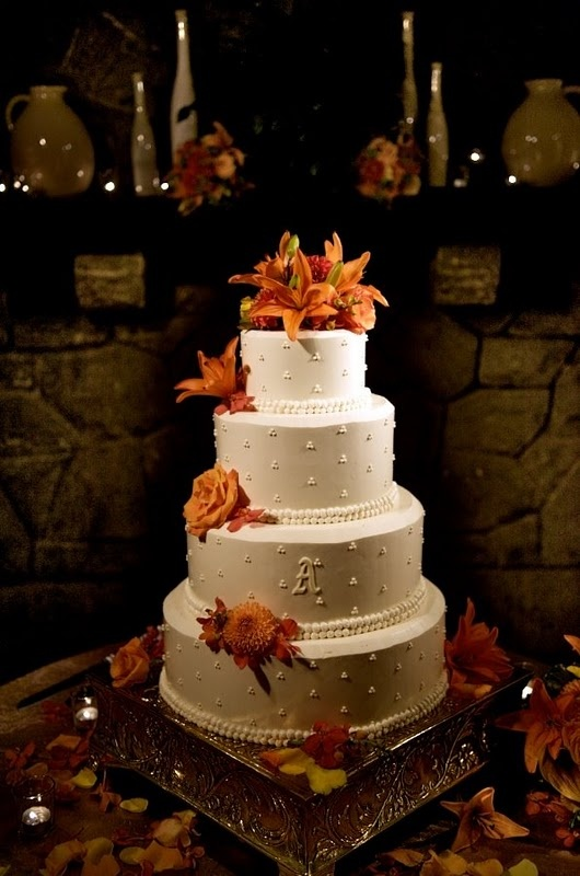 Wedding cake with tiger lilies - orange - now just make the cake simpler with no fondant and bam