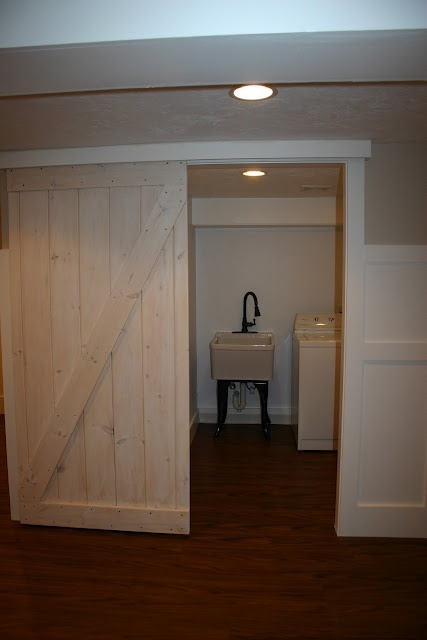 Using a sliding barn door to save space and add quirk. LOVE this - this is the door to use going into the workout room