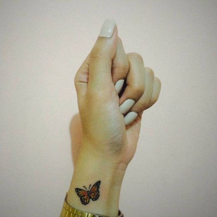 Small wrist tattoo of a butterfly on Kimberly.
