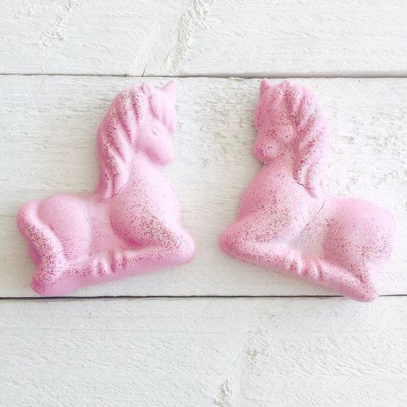 Unicorn Shaped Pink Bath Fizzy  Strawberry fragranced, glitter sprinkled bath bomb, packaged in a cello bag and tied up with a pink & purple