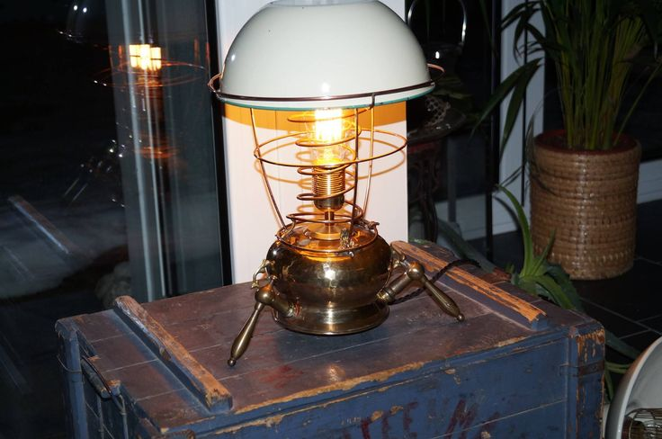 Definitely one-of-a-kind. Table lamp assembled with all sorts of parts. Steampunk-esque
