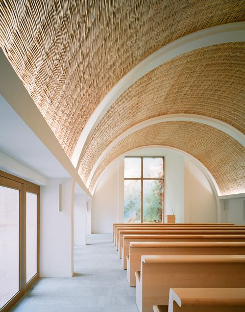 Forest Cemetry Chapel- Aalen. Kaestle Ocker Roeder Architekten. New radial roomshell: wooden substructure with insulation between rafters, mineral wool; wood particle board, two ply with intermediate vapour barrier; acoustic felt over cavity; panelling of woven willow.