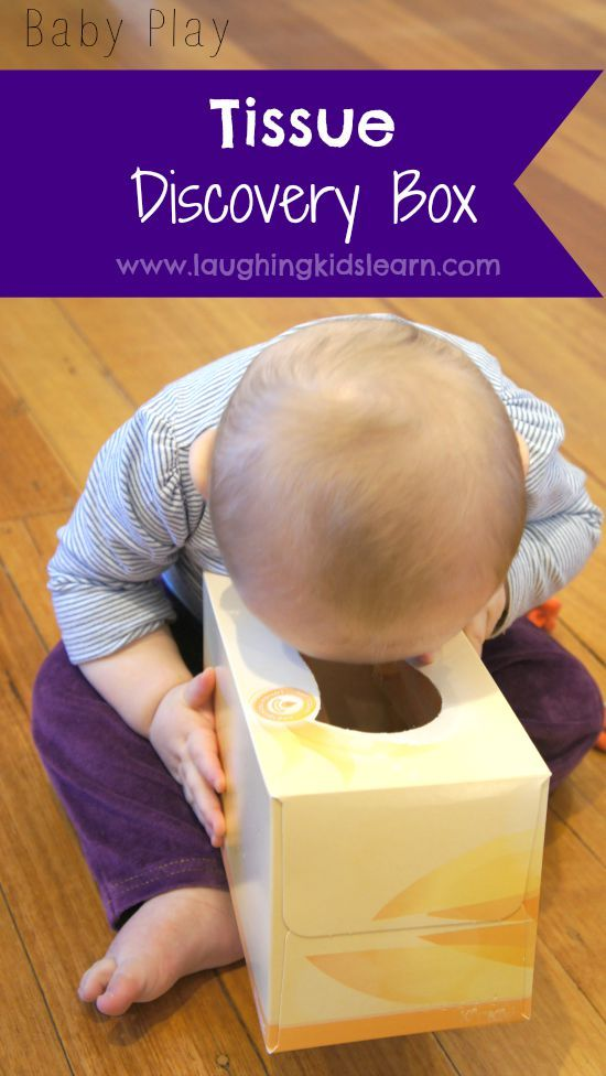 Baby play idea using a tissue box and sensory learning objects. A simple discovery box - Laughing Kids Learn