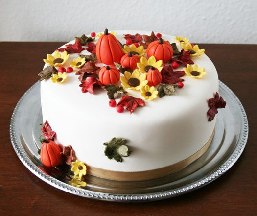 I make this birthday cake every year for my mother-in-law.  I usually make a carrot cake with cream cheese frosting, then I make the pumpkins with Marzipan.  Always a fun treat!