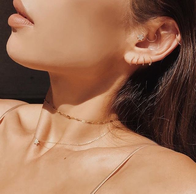 It's all in the details with minimal, dainty jewelry, like Rumi Neely's gold layered chokers and ear piercings