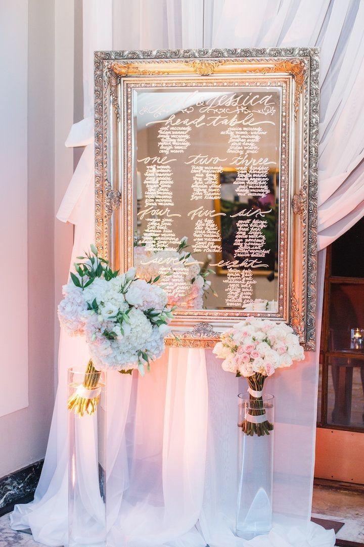 photo: Blush Wedding Photography; Elegant wedding reception seating chart idea;