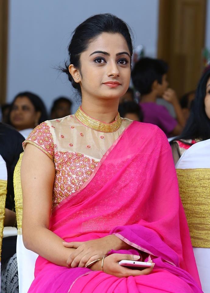 Namitha Pramod in pink saree with high neck blouse