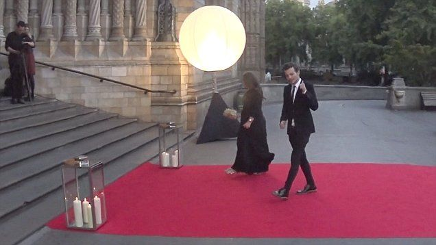 Louis Tomlinson arrived at London's Believe In Magic Charity Ball with his mother Johannah.  Tomlinson gave a thumbs up to photographers as he was cheered on by a slew of fans.