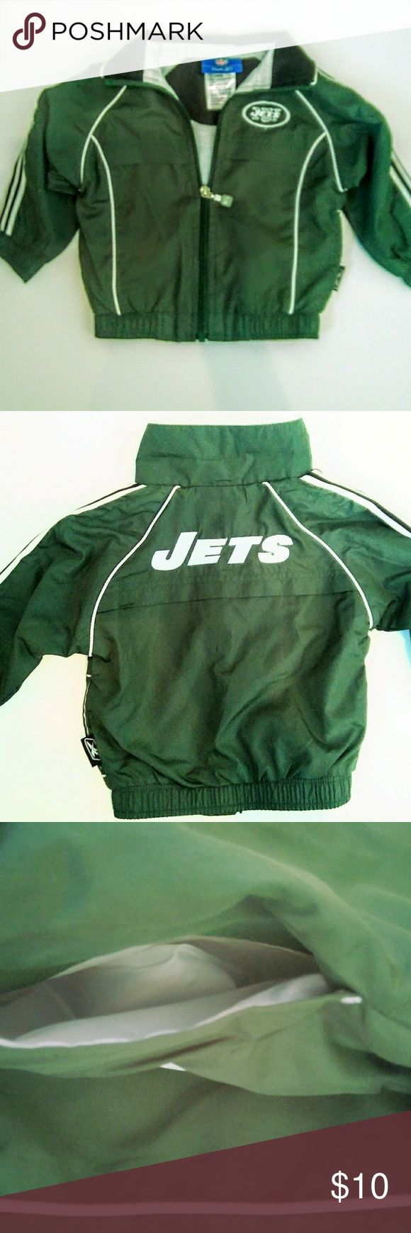 """Infant Official NFL Jets Jacket Infant wear for your """" Little Fan """"  Reebok Official New York Jets Nylon  Plastic Zippered  Green Black White Elastic wrist & waist 18 month old Jacket  ***Note : Zipper is good..but I did have too make sure its lined up to zip properly Reebok Jackets & Coats"""