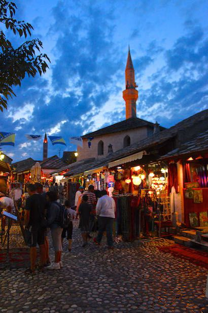 Take a stroll in the Old Bazar Kujundziluk, the oldest part of Mostar, and a cobble-stoned street resembling a Turkish Bazaar.  Several wooden artisan stalls line the street with carpets, jewelry, traditional garments, scarves and pipes.