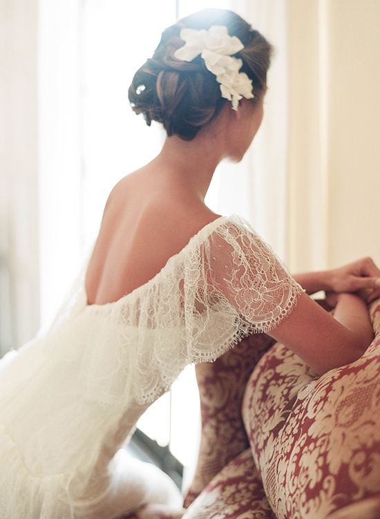Dying over this dress and her hair...  Gardenias and bun... umm yes! http://www.weddingchicks.com/2014/02/05/dos-pueblos-ranch-wedding-2/