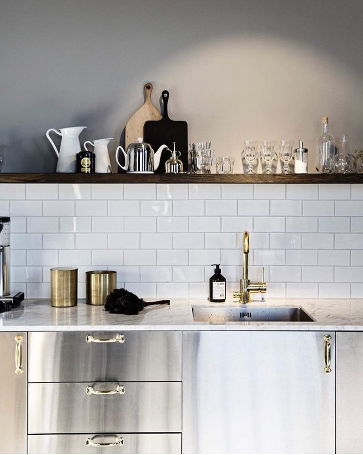 Ikea kitchen revamped with carrera marble top for office space.