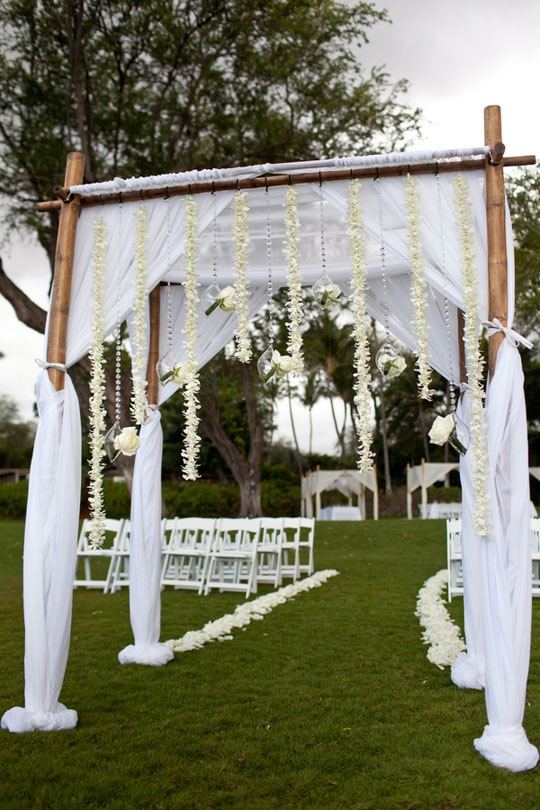 Wedding Arch: Bamboo, tulle, & floral strands / Dmitri & Sandra Photography via CeremonyBlog.com
