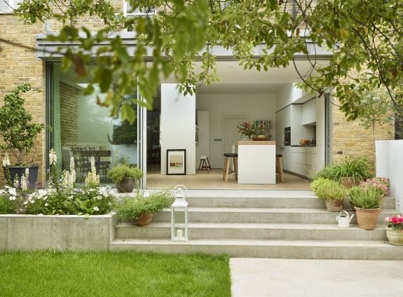 Looks like a 3x sliding door?Generous steps ease you out into the garden