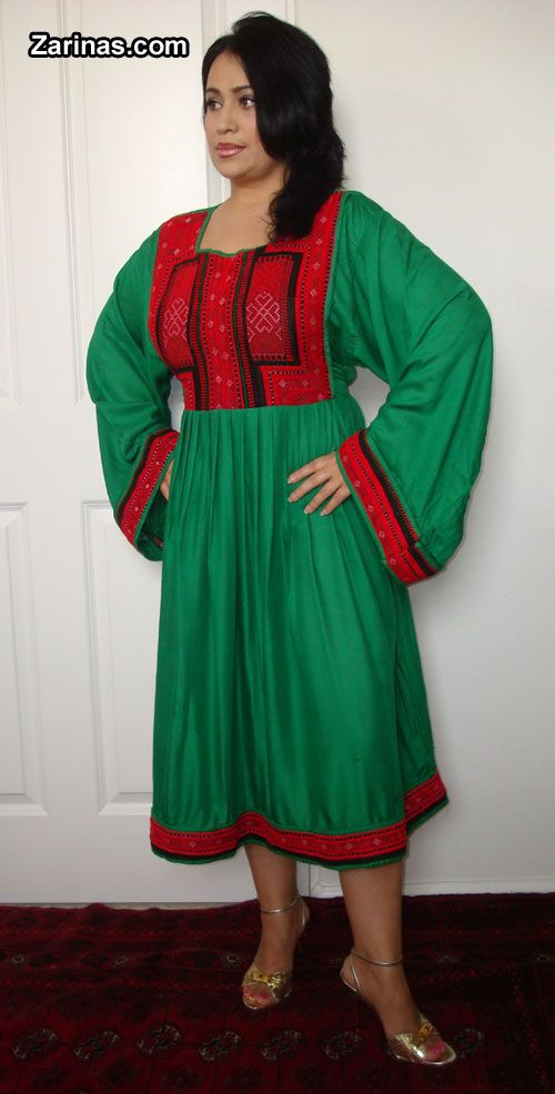Green Traditional Afghan Dress http://zarinas.com/dresses2.shtml  I believe this is called Gelam Dozi dress