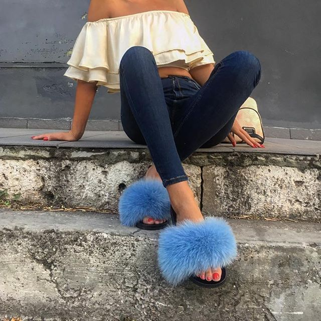 Take a walk on the wild side 🐾 👉🏻 @aggelikivictoria_koutava with the Summer blue fur slides!  👉🏻hauteacorn.com  .  .  #furslides #fluffyslides #furshoes #fursandals #furflipflops #slides #furslippers #slippers #sandals #shoes #indoor #outdoor #realfur #summer