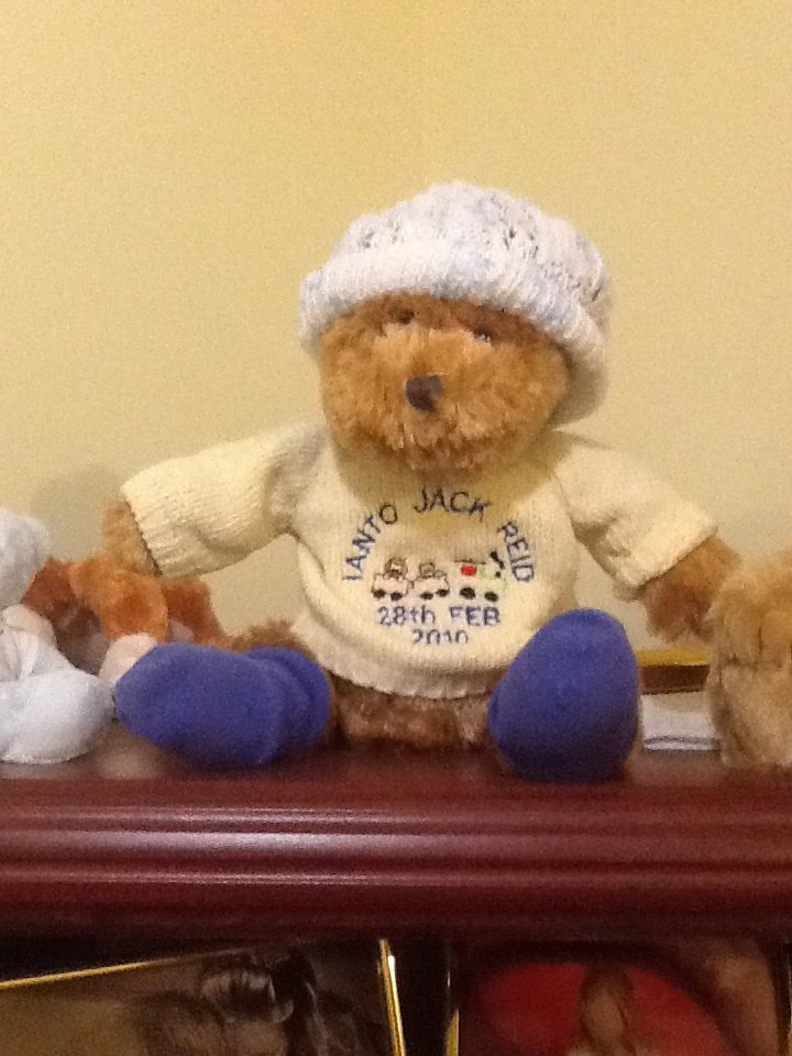 Day four: Treasured Item. This bear was bought for us the week Ianto was born. It wears one of the hats we had on him (it was too small so we replaced it). The bear takes Ianto's place in family photos etc. and has even been on holiday with us!