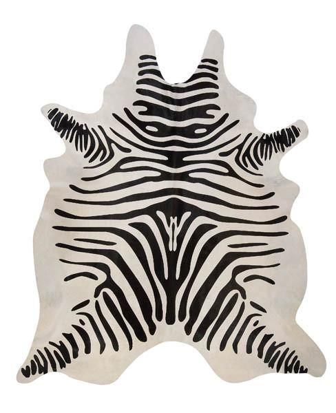 This stenciled zebra on acowhide can be a great accent piece in any room. It will look greatina home or office with styling ranging fromSouthwestern to modern.Brazilian cowhides are the highest quality due to their more supple hide and crisp colors. These beautiful natural cowhides are durable and will last a very long time. Below are the average sizes which are measured from the longest points of the cowhide: Average Size: 7' x 6' Cowhides are all unique! You will receive a hi...
